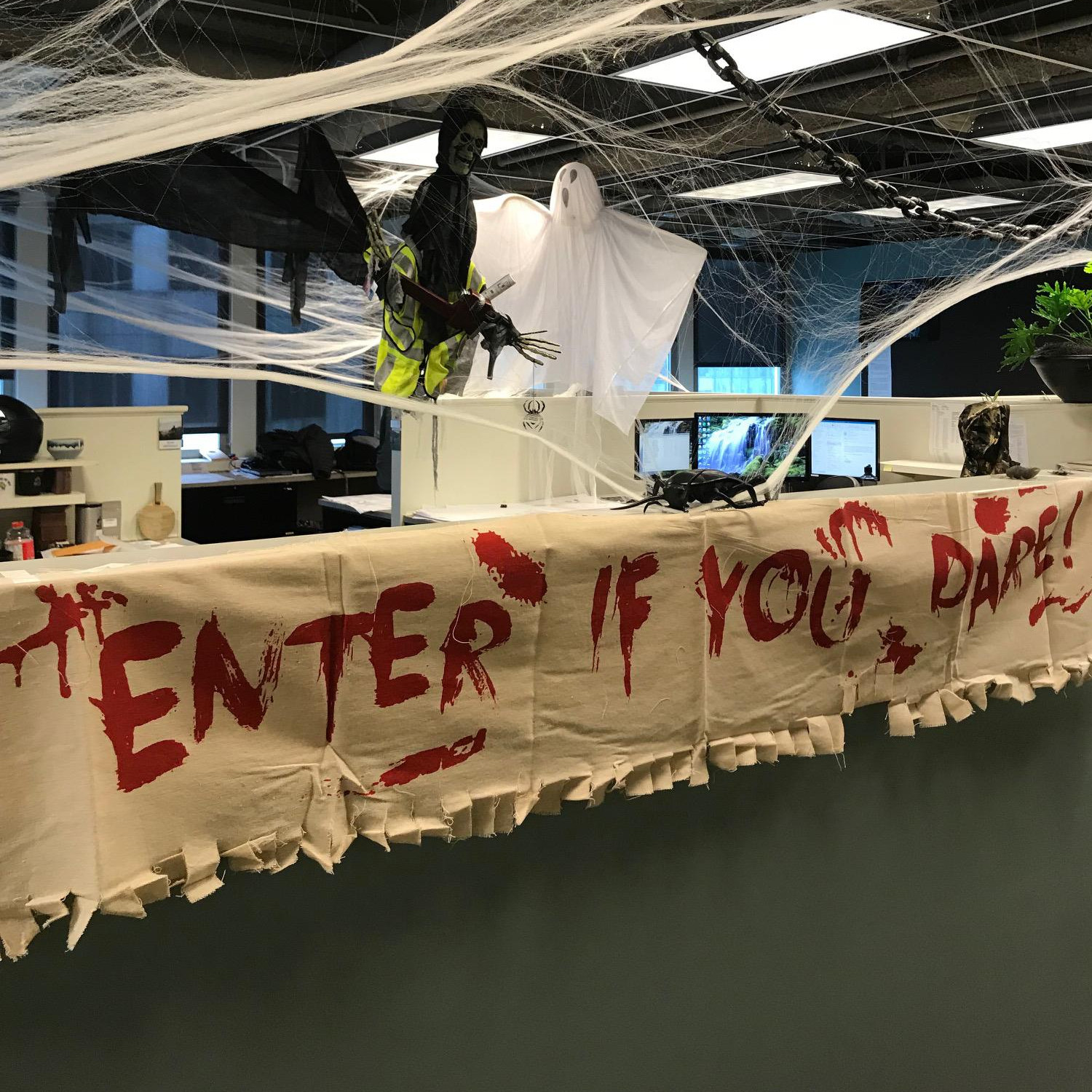 Spider webs and scary sign for Halloween at CJS offices